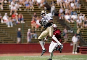 Oct 4, 1997: Notre Dame wide receiver Bobby Brown catches the ball as Stanford defensive back Corey Hill hits him during a game at Stanford Stadium in Palo Alto, California. Stanford won the game, 33-15. (Otto Greule /Allsport)