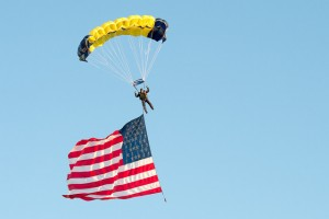 A member of the Navy Leap Frogs, the U.S. Navy's Parachute Demonstration Team, chutes on to the field before a football game at Notre Dame Stadium in South Bend, Ind., Sept. 6, 2014. DoD Photo by Mass Communication Specialist 1st Class Daniel Hinton.