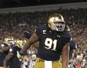 SAM HOUSEHOLDER   THE GOSHEN NEWS Notre Dame defensive end Sheldon Day celebrates a sack during the game Sept. 5 against Texas. The Fighting Irish beat the Longhorns 38-3.