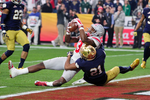 Ohio State wide receiver Michael Thomas (3) scores a 15 yard touchdown as Notre Dame cornerback Nick Watkins (21) defends. Matt Kartozian-USA TODAY Sports